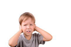 Boy 5 years shut by the hands ears. Horizontal Image isolated on white background Stock Photos