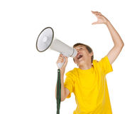 Boy yelling into a megaphone. Young boy talking and yelling into a megaphone Stock Photos
