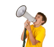 Boy yelling into megaphone Royalty Free Stock Photography