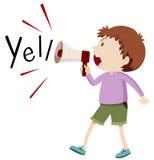 Boy yelling through speaker Stock Photos