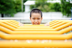 Boy and yellow bar Royalty Free Stock Images