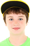Boy in Yellow Cap Stock Photo