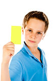 Boy with yellow card Royalty Free Stock Photos