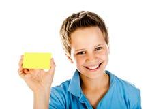 Boy with yellow card Stock Photos
