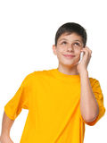 Boy in yellow with a cell phone Royalty Free Stock Photos