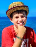 Boy with yellow hat smiling Stock Photo