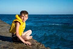 Boy in yellow life jacket Royalty Free Stock Images