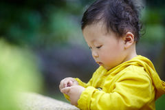 Boy in yellow Stock Images