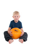 Boy with a yellow pumpkin Royalty Free Stock Image