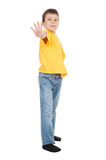 Boy in yellow reach out stock images
