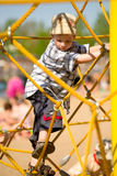 Boy on yellow ropes. Boy on playground climbing net of yellow ropes Stock Images