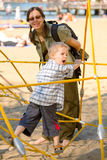 Boy on yellow ropes with mom Royalty Free Stock Image