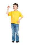Boy in yellow tshirt writes Stock Photo