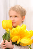 Boy with yellow tulips Royalty Free Stock Photography