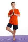 Boy in Yoga Pose. Boy Doing Yoga Pose in a Studio Stock Photography