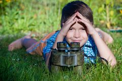 Boy young researcher exploring with binoculars environment in green garden Stock Photography