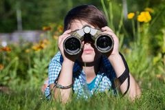 Boy young researcher exploring with binoculars environment in green garden Stock Images