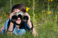 Boy young researcher exploring with binoculars environment in summer garden. Boy young researcher exploring with binoculars environment in green garden royalty free stock image