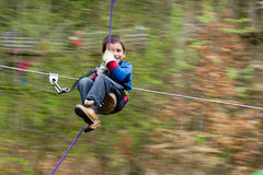 Boy on zip line Royalty Free Stock Image