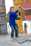 Boy with zip line. Boy preparing for ride on zip line. Trademarks have been removed stock photos