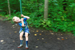 Boy on Zip Wire Pulling a Face Stock Images