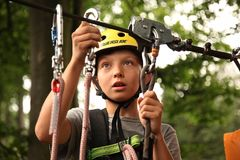 Boy on zipline royalty free stock images