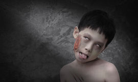 Boy in zombie make up for Halloween. Young Asian boy in zombie make up for Halloween Stock Photo