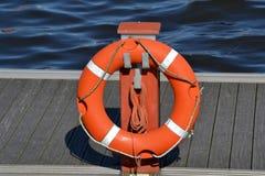 Boya de vida en un puerto Foto de archivo libre de regalías