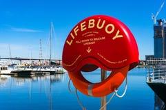 Boya de vida roja brillante en Docklands Foto de archivo libre de regalías