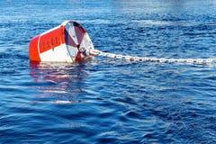 Boya en cadena en el mar Imagen de archivo libre de regalías