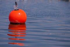 Boya en el agua Foto de archivo