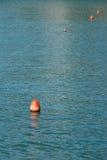 Boya roja en agua Imagen de archivo libre de regalías