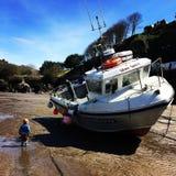 Boya y su barco Imagen de archivo libre de regalías