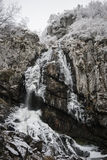 Boyana Waterfall is Frozen. On the first day of winter in the mountain forest this waterfall was already frozen Vitosha mountain, Sofia, Bulgaria Stock Image