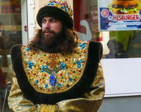 Boyar in the clothing of the 18th century and Hesburger. Offset time or bold advertising on the street in Moscow stock images
