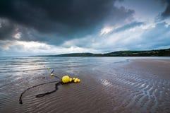 Boyas amarillas de la playa Fotos de archivo libres de regalías