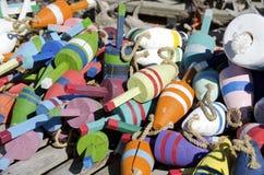 Boyas coloridas de la langosta de Maine foto de archivo