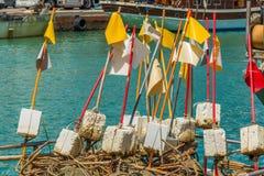 Boyas de la espuma de poliestireno con las banderas coloreadas Fotografía de archivo libre de regalías