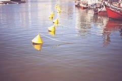 Boyas en el puerto fotografía de archivo libre de regalías
