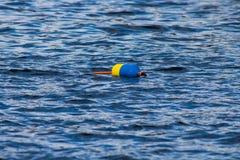 Boyas que flotan en el agua Fotografía de archivo libre de regalías