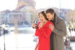 Boyfriend asking marry to his glad girlfriend stock photos
