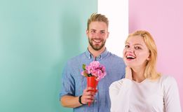 Boyfriend bring bouquet flowers to surprise her. Man ready for perfect date. Macho likes to surprise woman. Bouquet. Flowers always pleasant gift idea. Girl royalty free stock photo