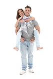 Boyfriend carrying girl on back, laughing Royalty Free Stock Photography