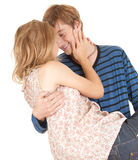 Boyfriend carrying girl in his arms Stock Image