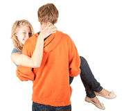 Boyfriend carrying girl in his arms Stock Photo