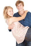 Boyfriend carrying girl in his arms, Stock Photography