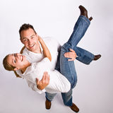 Boyfriend carrying girlfriend stock photography