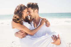Boyfriend carrying his girlfriend Stock Photography