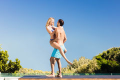 Boyfriend carrying his girlfriend Royalty Free Stock Images