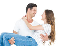 Boyfriend carrying his girlfriend Royalty Free Stock Photography
